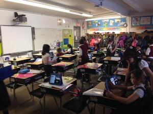 My class thoroughly engaged in their iMovie project.